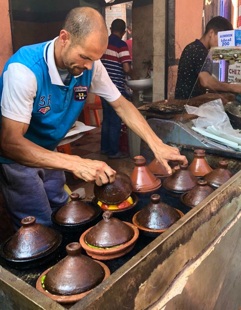 Tagines cooking in a Marrakech souk