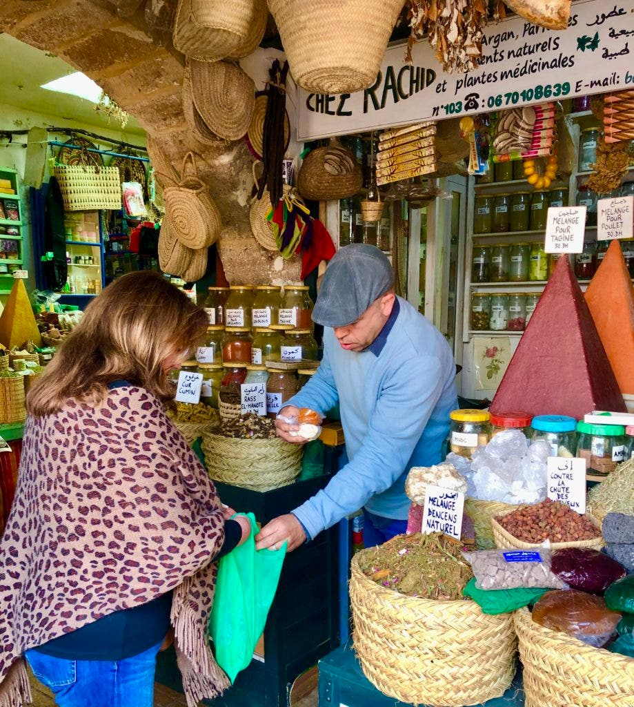 Shopping for freshly ground spices in Essaouira on Morocco's Atlantic coast